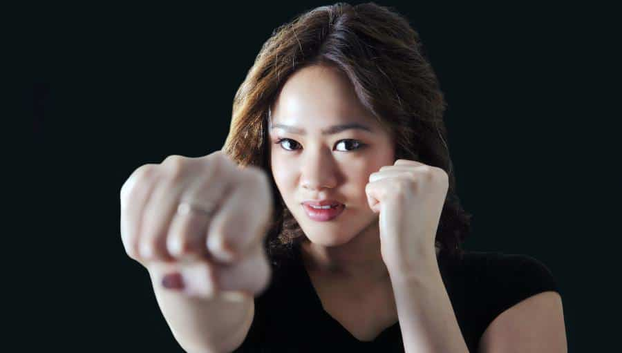 woman fighting back with a punch