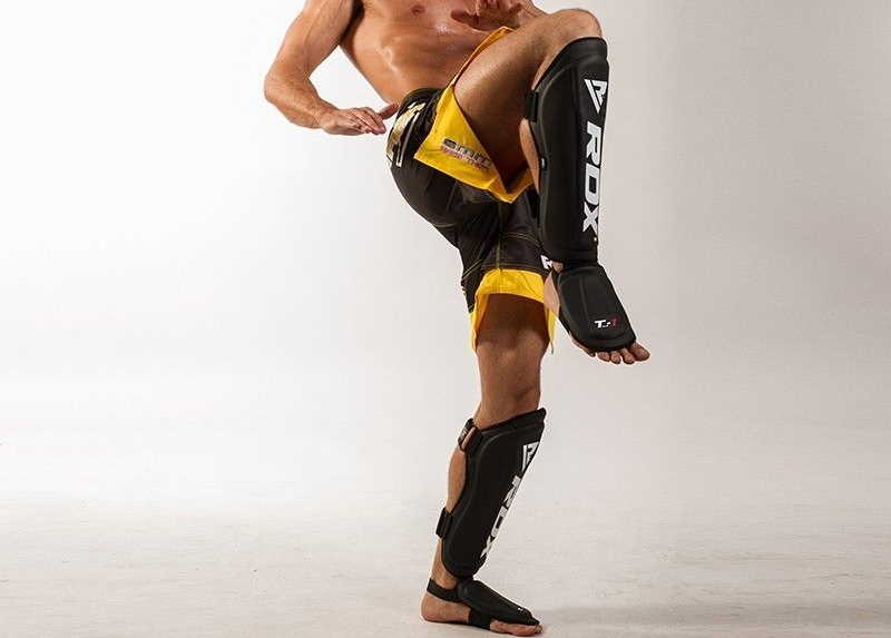guy with muay thai shin guards