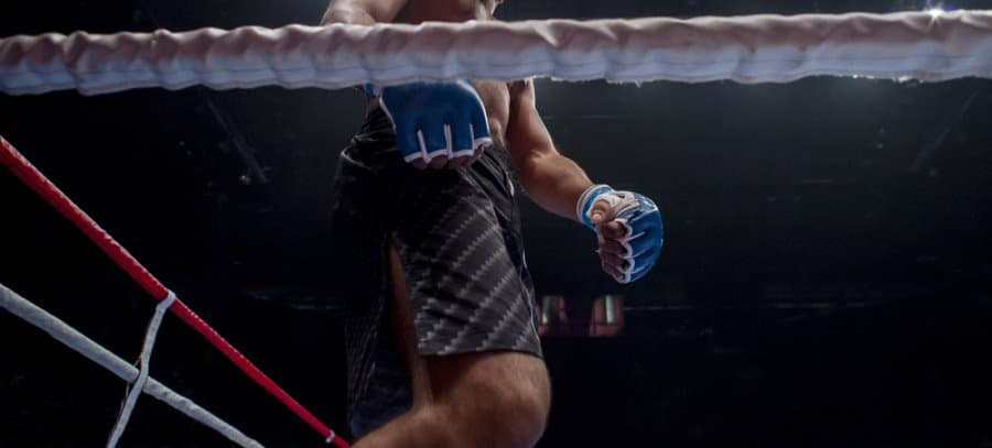 Man in ring with MMA shorts